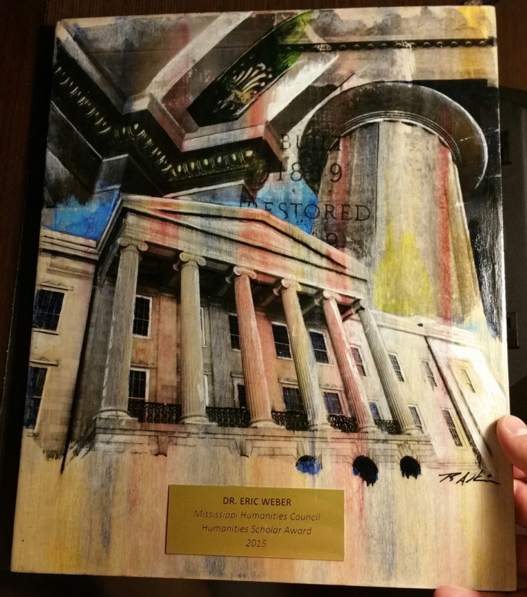 The artwork that the Mississippi Humanities Council commissioned to serve as an award plaque for the 2015 Humanities Scholar Award I received. The artwork depict Jackson, Mississippi's Old Capitol building.