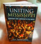 Paperback editions featuring the cover of 'Uniting Mississippi.'