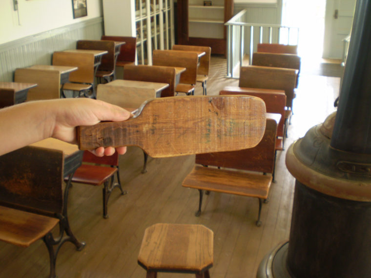 Image of a paddle in a traditional school classroom.