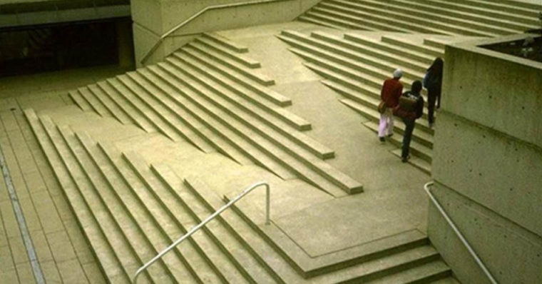 This is a photo of a modern staircase designed with ramps running zig zag up the diagonals of the staircase.
